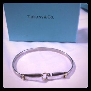Authentic Tiffany and Co. sterling silver bangle.